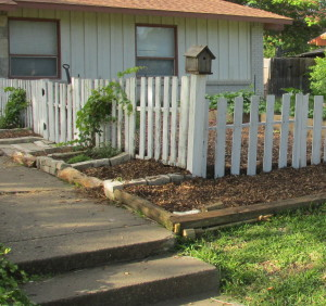 This part of fence with gate needs to be cut shorter for approval from city.