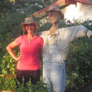 Dash with scarecrow in garden